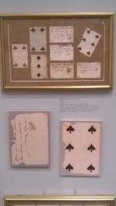 They sometimes used playing cards as currency. These have notes on the back indicating they're good for two loaves of bread--about 12 1/2 cents.